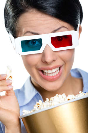 Headshot of the girl in 3D spectacles eating popcorn and watching the movie, isolated on white photo