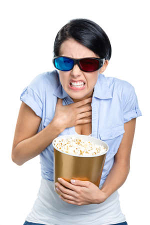 Girl in 3D glasses watching movie with the bowl full of popcorn, isolated on white photo