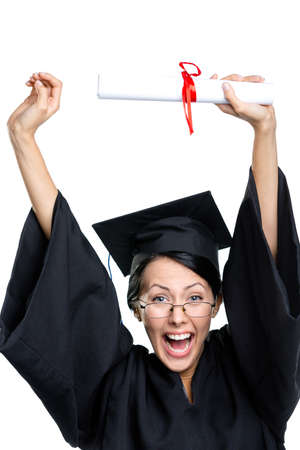 academic robe: Graduating student in glasses and black academic robe puts the diploma over the head, isolated on white Stock Photo