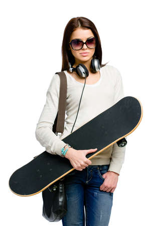Half-length portrait of teenager with skateboard wearing sunglasses, earphones and bag, isolated on white. Concept of young generation Stock Photo - 24480826