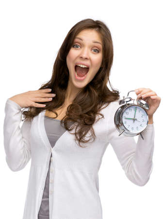 Half-length portrait of shouting woman keeping alarm clock, isolated on white photo