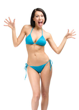 Full-length portrait of young woman wearing blue bikini, isolated on white. Concept of summer holidays and traveling photo