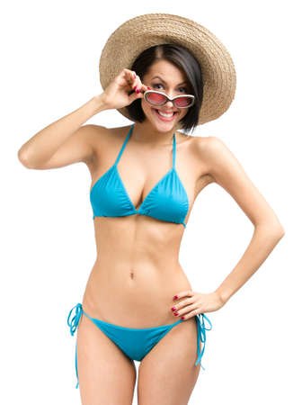 Portrait of woman wearing bikini, hat and sunglasses, isolated on white. Concept of summer holidays and traveling photo