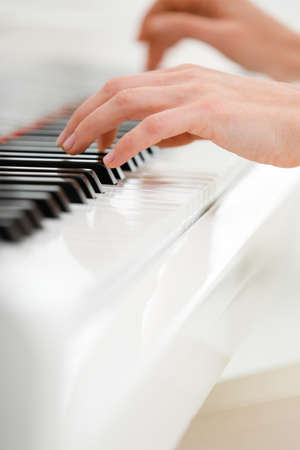 Close up view of hands playing piano. Concept of music and art photo