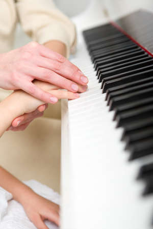 avocation: Close up of hands playing piano. Concept of music and enjoyment