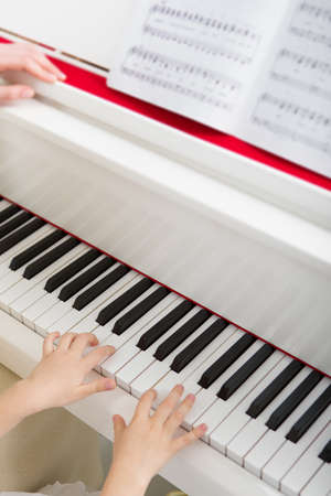 Close up of hands playing piano. Concept of music and art Stock Photo - 24481080