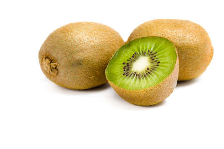 Close up of three kiwis and one is cut, isolated on white. Concept of healthy eating and dieting lifestyle photo