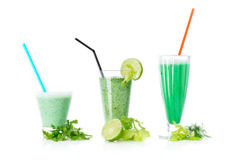 Close up of three green cocktails, isolated on white. Concept of healthy lifestyle and dieting photo