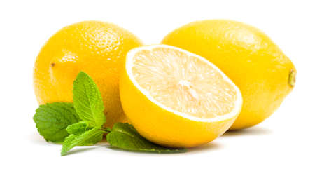 Close up of lemons with melissa, isolated on white. Concept of healthy eating and dieting lifestyle photo