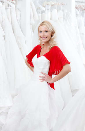 Young girl is seeking for a wedding gown that will suit her photo