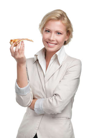Business woman eating piece of pizza, isolated on white photo