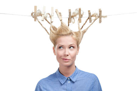 clothes pegs: Woman with creative hairstyle of clothes pegs, isolated on white