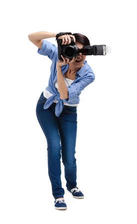 Lady-photographer takes photos, isolated on white Stock Photo - 25595605