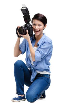 Woman-photographer takes snaps, isolated on white Stock Photo - 25595607