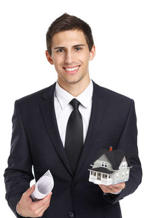 Half-length portrait of businessman who hands model house and blueprint, isolated on white. Concept of real estate and business photo