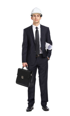Full-length portrait of engineer in helmet handing layout and briefcase, isolated on white. Concept of construction and  engineering photo