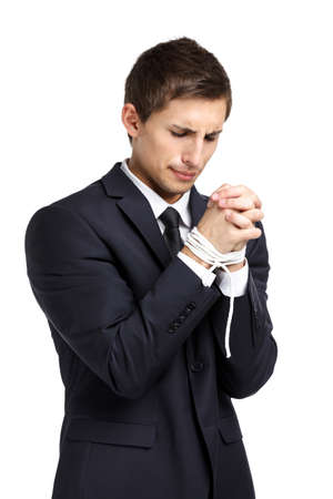 hair tied: Half-length portrait of businessman with tied hands, isolated on white. Concept of slavery and hard work