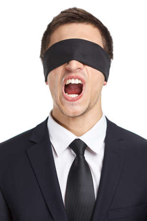 servitude: Portrait of blind-folded businessman who screams, isolated on white. Concept of slavery and violence