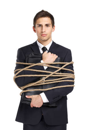 servitude: Portrait of businessman handing briefcase who tied with the rope, isolated on white. Concept of slavery and violence Stock Photo