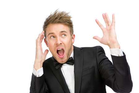 hysterics: Half-length portrait of scared and screaming business man with hands up, isolated on white