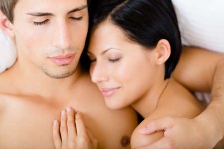 sexy wife: Close up of couple sleeping in bed, top view. Concept of love and affection