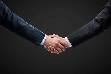 Close up view of hand shake of business people. Concept of trustworthy relations and business cooperation Stock Photo - 25536213