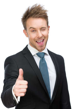 Half-length portrait of manager who thumbs up, isolated on white. Concept of leadership and success photo