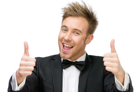 Portrait of businessman who thumbs up with two hands, isolated on white. Concept of leadership and success photo