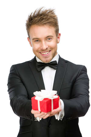 Half-length portrait of businessman holding gift box, isolated on white. Concept of holidays and gifts photo