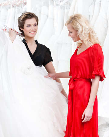 making dresses: Future bride is in two minds concerning the wedding dress. Stock Photo