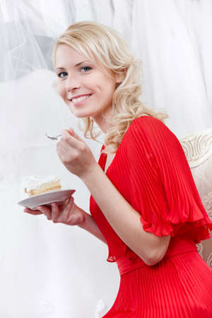 show off: Future bride eats a delicious cake, on white background