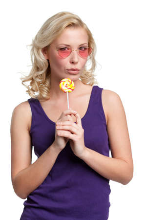 sugarplum: Woman in heart shaped glasses with lolly, isolated on white