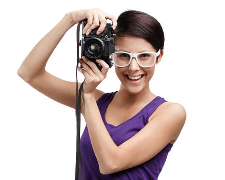Girl in spectacles hands professional photographic camera, isolated on white photo
