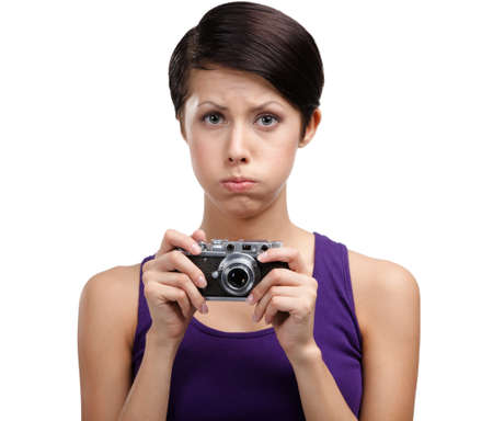 Attractive girl in spectacles hands retro photographic camera, isolated on white Stock Photo - 26692132