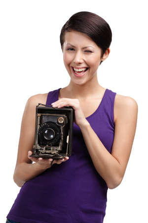 Woman with exclusive photographic camera, isolated on white Stock Photo - 26692133