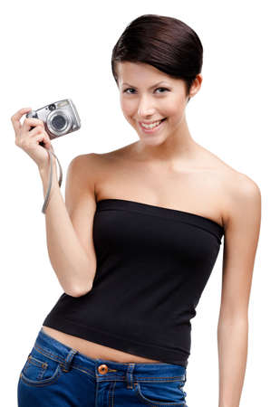 Creative girl holds amateur hand-held  silver camera, isolated on white Stock Photo - 26692134