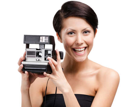 Lady takes pictures with cassette photographic camera, isolated on white photo