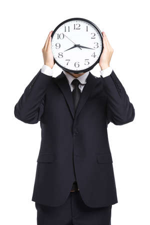 Half-length portrait of businessman holding clock in front of his face, isolated on white Stock Photo