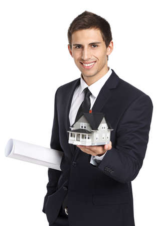 architecting: Half-length portrait of businessman who hands model house and layout, isolated on white. Concept of real estate and business Stock Photo