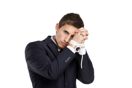 servitude: Half-length portrait of businessman with bound hands, isolated on white. Concept of slavery and hard work