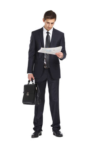 Full-length portrait of businessman handing briefcase and reading docs, isolated on white. Concept of business and success photo
