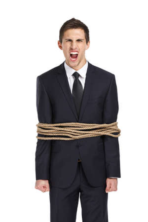 servitude: Portrait of screaming businessman tied with the rope, isolated on white. Concept of slavery and violence