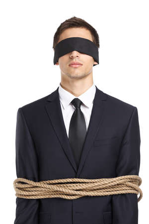 servitude: Portrait of  blind-folded businessman tied with the rope, isolated on white. Concept of slavery and violence