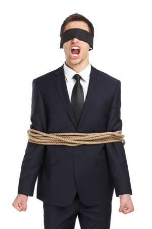 hysterics: Portrait of blind-folded businessman tied with the rope and screaming, isolated on white. Concept of slavery and violence