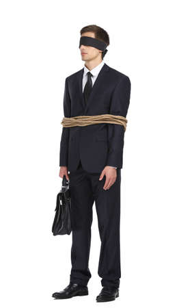 servitude: Full-length portrait of blind-folded businessman tied with the rope, isolated on white. Concept of slavery and violence Stock Photo