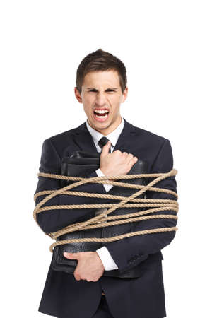 servitude: Portrait of businessman screaming and handing briefcase who tied with the rope, isolated on white. Concept of slavery and violence Stock Photo