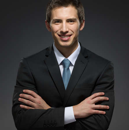 professionalism: Half-length portrait of business man with his arms crossed. Concept of professionalism and business success
