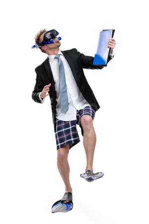 Full-length portrait of business man wearing fins, snorkel and goggles hands folder with documents, isolated on white photo