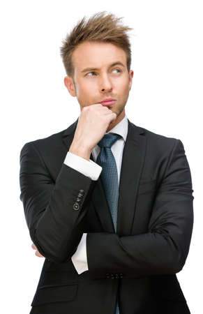 Half-length portrait of pensive businessman touching face, isolated. Concept of leadership and success photo