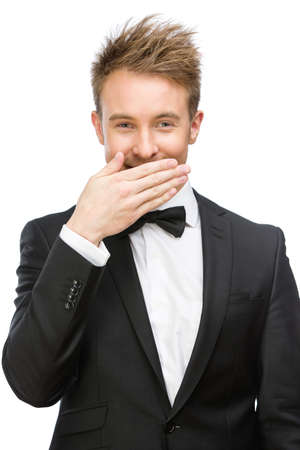 Half-length portrait of laughing businessman who covers mouth with hand, isolated on white photo